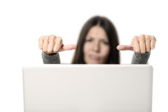 Unhappy Young Woman Showing Thumbs on Sides Stock Photography