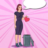 Unhappy Young Woman Throws Her Heart in the Trash. Unrequited Love. Pop Art illustration Stock Photo