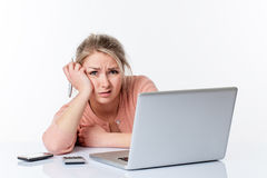Unhappy young woman working hard, looking disgusted and scared Royalty Free Stock Images