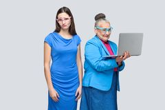 Unhappy young woman standing near happiness older woman work com royalty free stock photography