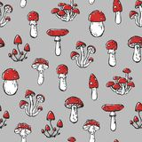 Seamless stylized unhealthy poisonous amanita mushrooms pattern texture element on neutral background.  Royalty Free Stock Photography