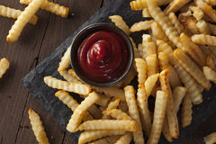 Unhealthy Baked Crinkle French Fries stock photography
