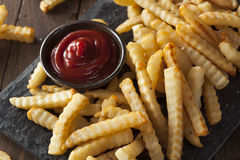 Unhealthy Baked Crinkle French Fries Royalty Free Stock Image