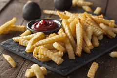Unhealthy Baked Crinkle French Fries Stock Images