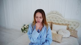 Portrait of Female Suffering From Cold Cough and Sore Throat, Looking at Camera. Unhealthy Beautiful Girl Sick and Suffering From Cough. Enjoys Pharmaceuticals Stock Photo