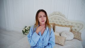 Portrait of Female Suffering From Cold Cough and Sore Throat, Looking at Camera stock photos