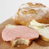 Unhealthy breakfast. Bread and fat sausage closeup stock images
