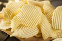 Unhealthy Crinkle Cut Potato Chips Stock Photo