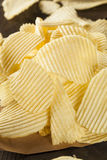 Unhealthy Crinkle Cut Potato Chips Royalty Free Stock Photo