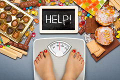 Unhealthy diet - overweight Royalty Free Stock Image