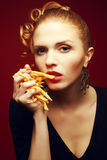 Unhealthy eating. Junk food concept. Girl with fries Royalty Free Stock Images