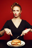 Unhealthy eating. Junk food concept. Portrait of eating lady Royalty Free Stock Images