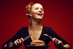 Unhealthy eating. Junk food concept. Portrait of a happy blonde Royalty Free Stock Photos