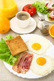 Unhealthy fatty breakfast with cup of coffee with bacon,eggs. On linen background Stock Photos
