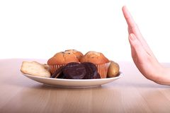 Unhealthy food. Image of a woman refusing a plate of unhealthy food Royalty Free Stock Photography