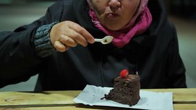 Unhealthy food. Dessert at dinner. Plump woman eating brownie with strawberries. Stock footage stock video footage