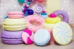 Unhealthy food - giant artificial sweets and pastry decorations stock photography