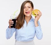 Woman licking her lips holding burger. Unhealthy food has a very attractive taste. Woman licking her lips holding burger Stock Photos