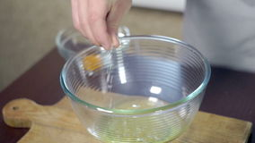 Unhealthy food ingredient. Chef adding salt to protein in glass bowl stock video footage