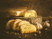Unhealthy garlic bread and cakes Royalty Free Stock Photos