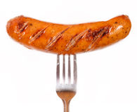 Unhealthy grilled barbecue sausage Royalty Free Stock Images