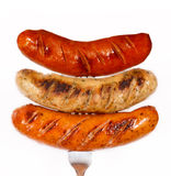 Unhealthy grilled barbecue sausage Royalty Free Stock Image