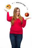 Unhealthy and healthy food. The concept of dieting and healthy lifestyle for fat woman Royalty Free Stock Photos