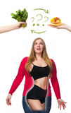 Unhealthy and healthy food. The oncept of dieting and healthy lifestyle for fat woman stock photo