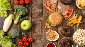 Unhealthy or healthy food. Top view stock photo