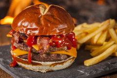 Unhealthy Homemade Barbecue Bacon Cheeseburger Royalty Free Stock Photo