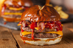 Unhealthy Homemade Barbecue Bacon Cheeseburger Royalty Free Stock Images