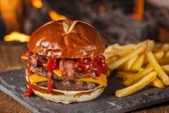 Unhealthy Homemade Barbecue Bacon Cheeseburger Stock Photography