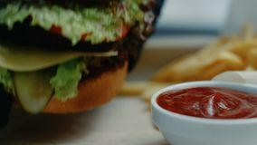 Unhealthy junk food dinner hamburger menu set. Unhealthy junk food dinner. hamburger and french fries menu set. tomato sauce stock video footage