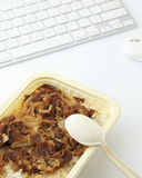 Unhealthy lunch box at office Royalty Free Stock Images