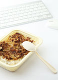 Unhealthy lunch at office Royalty Free Stock Photography