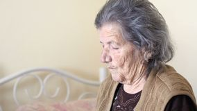 Unhealthy old woman get support for eating, feed by daughter stock video footage
