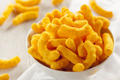 Unhealthy Orange Puffy Cheese Crisps Stock Image