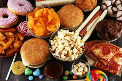 Unhealthy products. food bad for figure, skin, heart and teeth. Assortment of fast carbohydrates food. American unhealthy food stock photography
