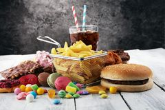 Unhealthy products. food bad for figure, skin, heart and teeth. Assortment of fast carbohydrates food royalty free stock photos