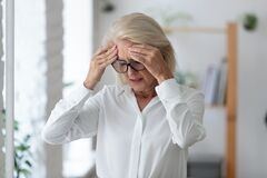 Free Unhealthy Senior Female Employee Suffer From Headache Royalty Free Stock Photography - 218958937