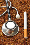 unhealthy tobacco cigarette and a stethoscope Stock Image
