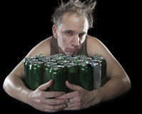 Unhealthy view man after drunk, near empty beer container Stock Photo