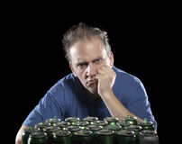 Unhealthy view man after drunk, near empty beer container Royalty Free Stock Image