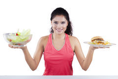 Unhealthy vs Healthy Food Concept Stock Photos