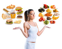 Unhealthy vs healthy food. Over white background stock images