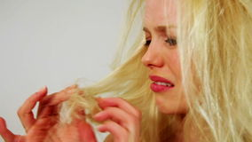 Unhealthy weak messy hair of unhappy young woman, studio. Unhealthy weak messy hair of unhappy young woman stock video