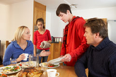 Unhelpful Teenage Clearing Up Royalty Free Stock Image