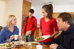 Unhelpful Teenage Clearing Up After Family Meal Royalty Free Stock Photos