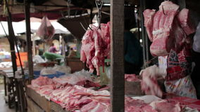 Unhygienic meats on ground without ice in asian market stock video
