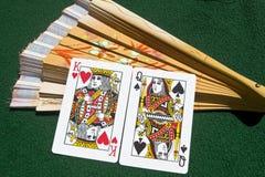 União de cartões de jogo e de um ventilador Fotos de Stock